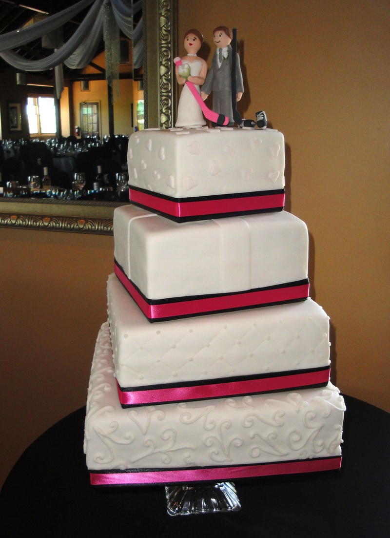 4 Tiered square Wedding Cake with Pink Accents