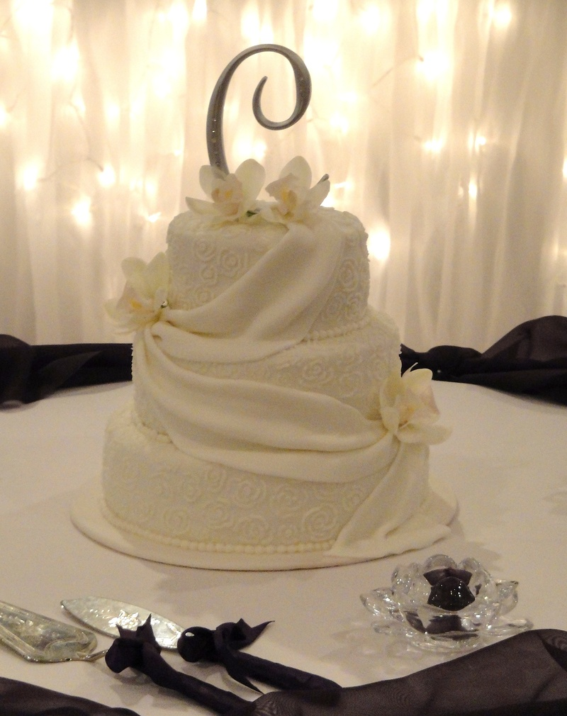 Fondant Drapes & White Orchids Wedding Cake